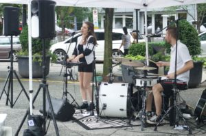 Rachel B performing for the people going to the Farmer's Market in Market Square on Thursday, June 23, 2016.